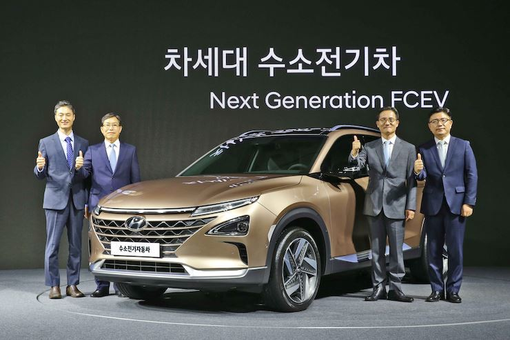 Hyundai Motor executives pose with the company's next-generation fuel cell electric vehicle during an unveiling event at the 63 Convention Center on Yeouido, Seoul, August. / Courtesy of Hyundai Motor