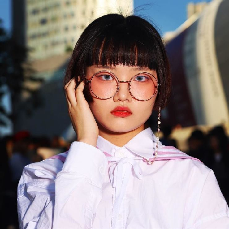 Ga-hee, a middle-school girl, has her own online business selling eyeglass accessories. / Courtesy of Michael Hurt