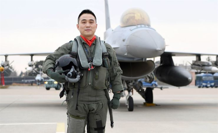Republic of Korea Air Force 38th Fighter Group pilot Major Kim Sang-won poses in front of a KF-16 fighter at the group's base in Gunsan, North Jeolla Province, Dec. 14. / Yonhap