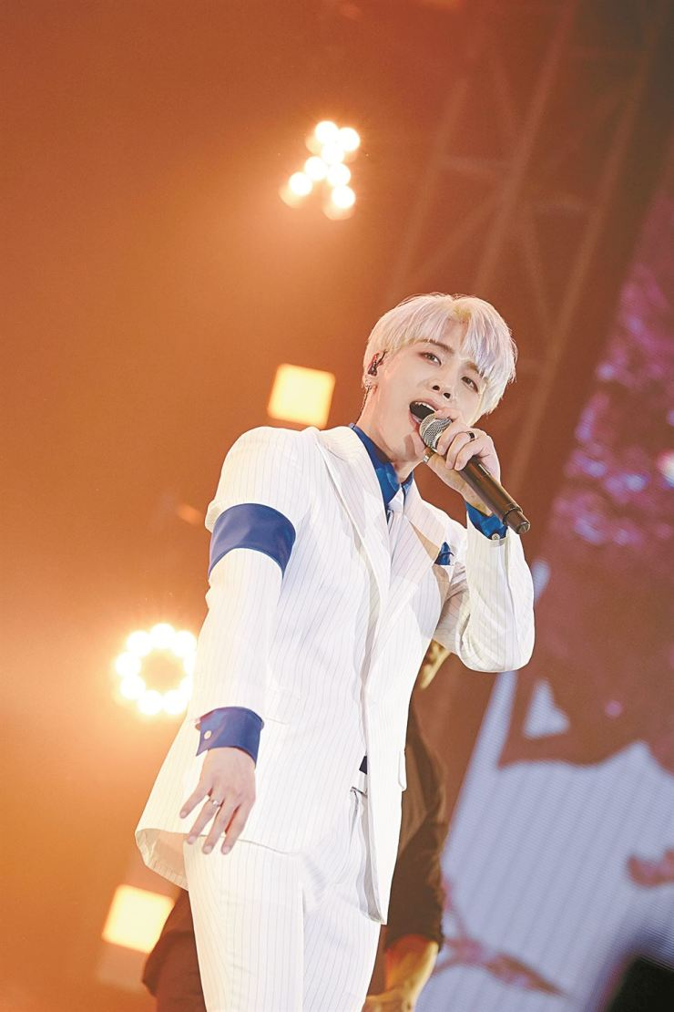 Singer Jonghyun performs during the solo concert 'INSPIRED' at Olympic Park in Seoul, Dec. 9. / Courtesy of S.M. Entertainment