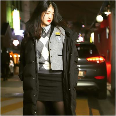 High school student and model Yeseul Pak models her 'long padding' coat and cool sneakers (in this case, Nike Air Force Ones) in an alley in Itaewon. / Photos by Michael Hurt