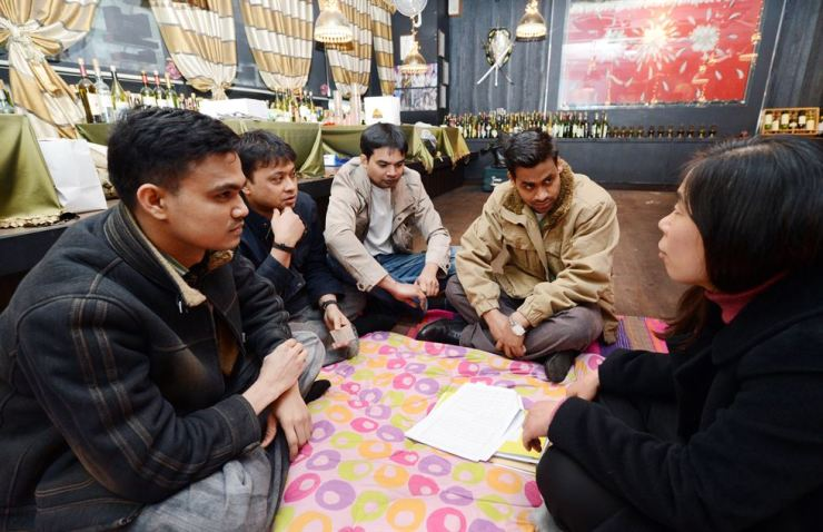 Indian restaurant workers in Seongnam, Gyeonggi Province, consult a labor attorney in March 2012 after the restaurant owner vanished without paying wages of tens of millions of won. The workers slept on the restaurant's floor for six months after the owner disappeared. / Korea Times file