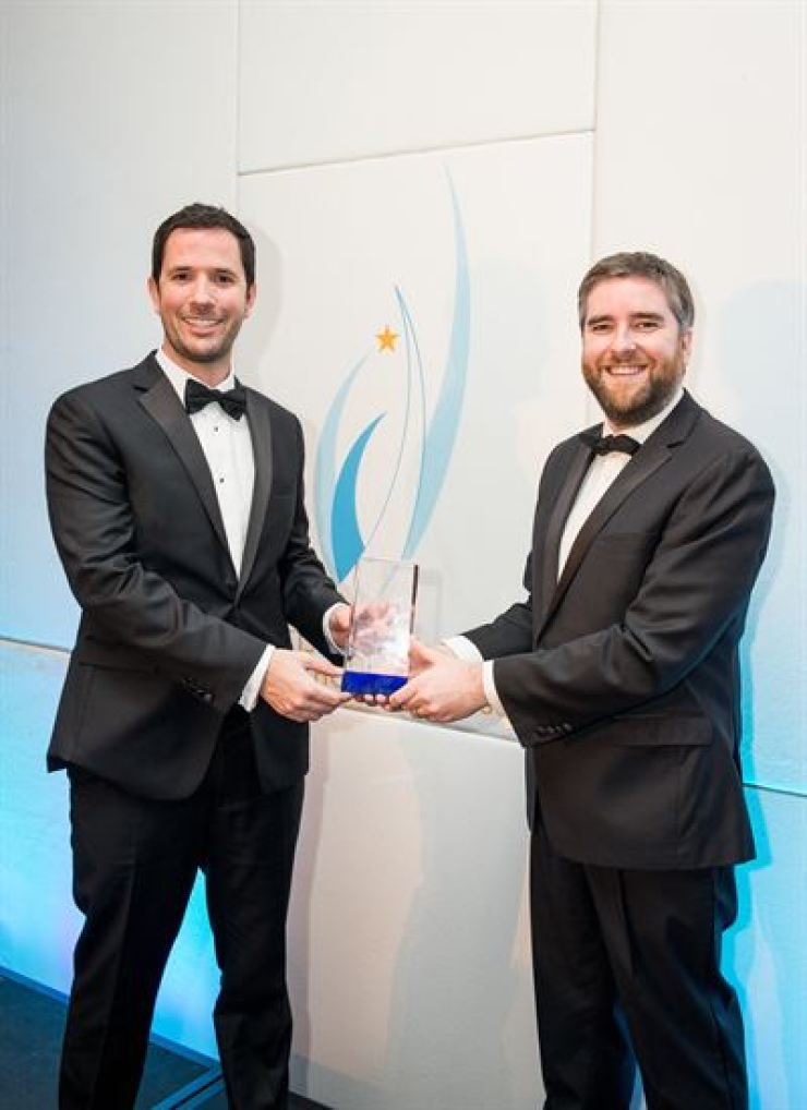 Dulwich College Seoul mathematics instructors Chris Bonnet, left and Neil Gorton receive the British International Schools Award for Teaching Initiative of the Year in London last Monday. / Courtesy of Charles Henderson
