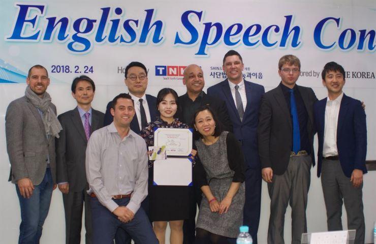 Speech contest winner Kim Jin-mi with TNKR members at Shin & Kim Law Firm in Seoul, Saturday. / Courtesy of John Redmond