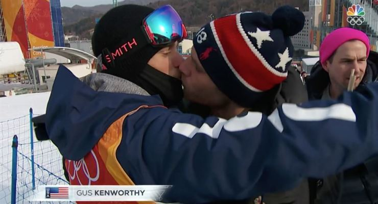 Gus Kenworthy, left, shares a kiss with Matt Wilkas in front of an NBC TV camera. / Courtesy of Kenworthy's Instagram page