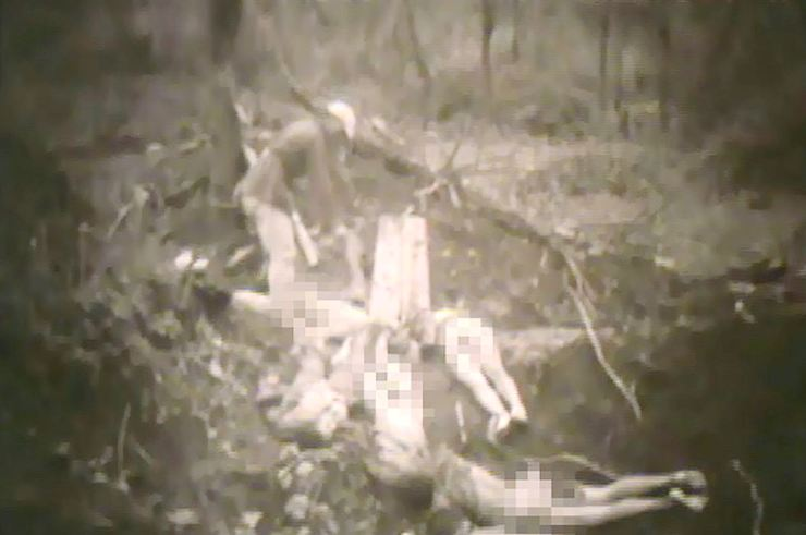 In a still from video footage from 1944, released Tuesday, a Chinese soldier takes a sock off one of the dead Korean sex slaves killed by the Japanese military. The Seoul Metropolitan Government and the SNU Human Rights Center released the 19-second footage through which an Allied Command soldier, surnamed Baldwin, filmed a mass grave site for Korean sex slaves in Tengchong, a western Chinese village bordering Myanmar. /Courtesy of Seoul Metropolitan Government and SNU Human Rights Center