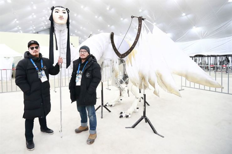 Figure 1PyeongChang Olympics opening ceremony art directors Im Choong-il, left, and Bae Il-hwan with Inmyeongjo, a mask made an appearance at the ceremony. / Courtesy of PyeongChang Olympics organizing committee