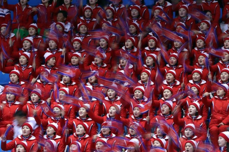 North Korea's cheerleading squad roots for competitors during the PyeongChang Winter Olympics figure skating pair short program at the Gangneung Ice Arena, Feb. 14. / Korea Times photo by Shim Hyun-chul