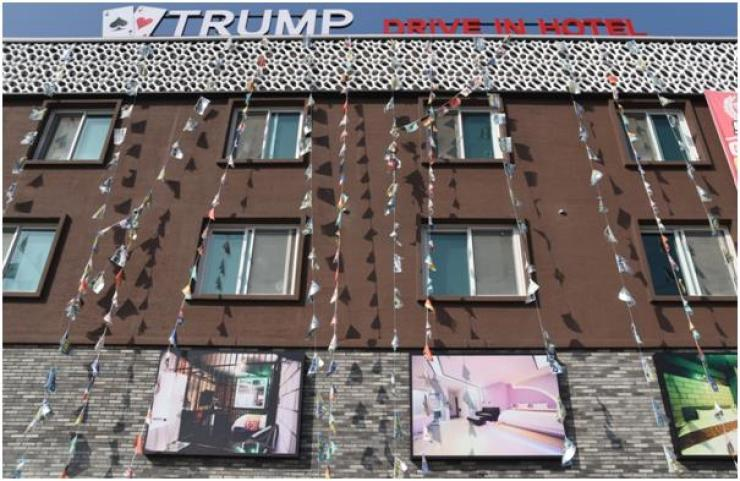 The exterior of Trump Hotel shows its theme rooms, including the prison cell. / Photo by Jon Dunbar