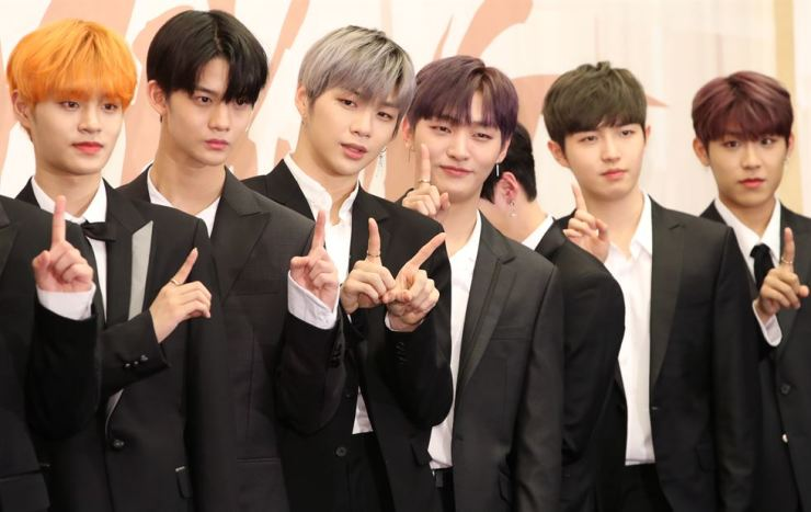 Boy band Wanna One poses during a showcase for its new album 'I Promise You' at a hotel in Seoul, Monday. / Yonhap