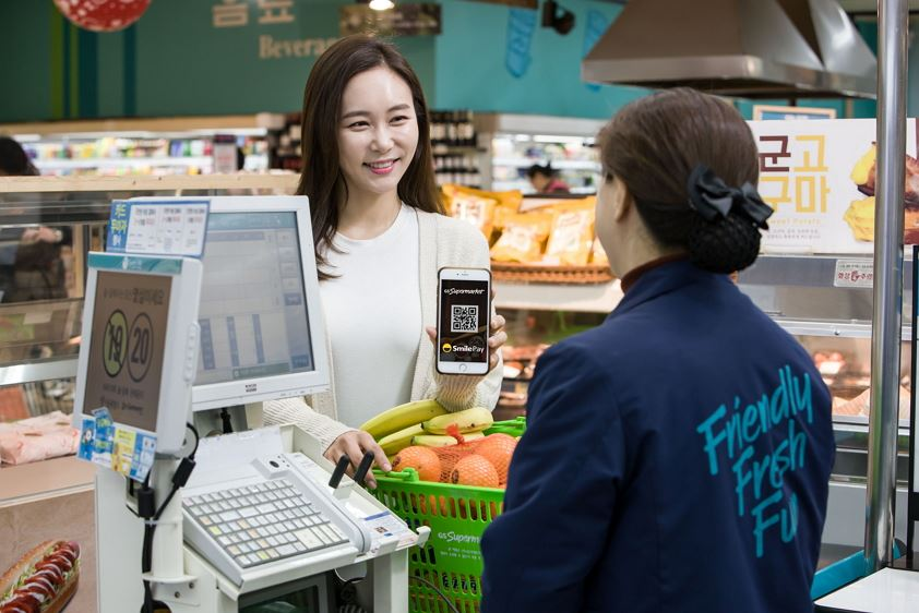 b58ca75afe Models demonstrate payment through eBay Korea's SmilePay system embedded in  GS Supermarket's new shopping app. Shoppers at the supermarket chain's  stores ...