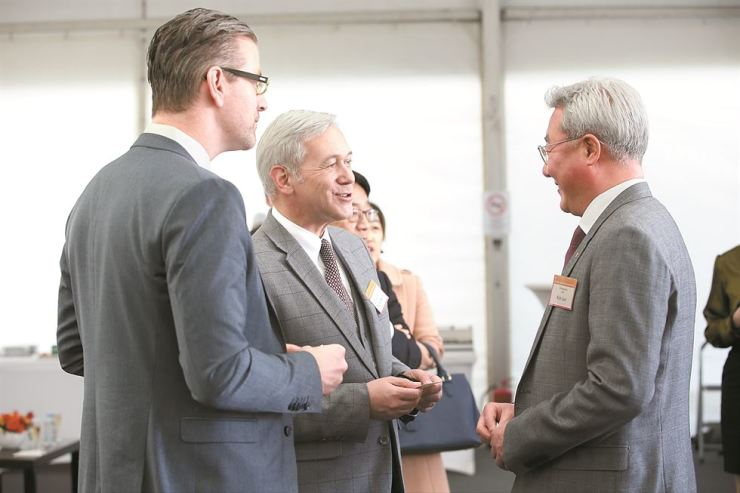SK Innovation CEO Kim Jun, right, talks with guests at the groundbreaking ceremony of the company's electric vehicle battery plant in Komarom, Hungary, Thursday. / Courtesy of SK Innovation