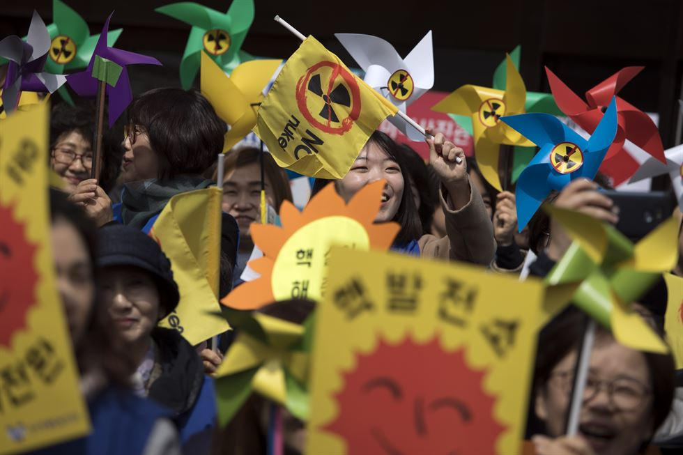 Anti-nuclear protesters in protective clothing and a puffy doll in the shape of a nuclear reactor stand in front of Korea YWCA's office in Myeong-dong, Jung-gu, Seoul, Mar. 20. / Korea Times photo by Choi Won-suk