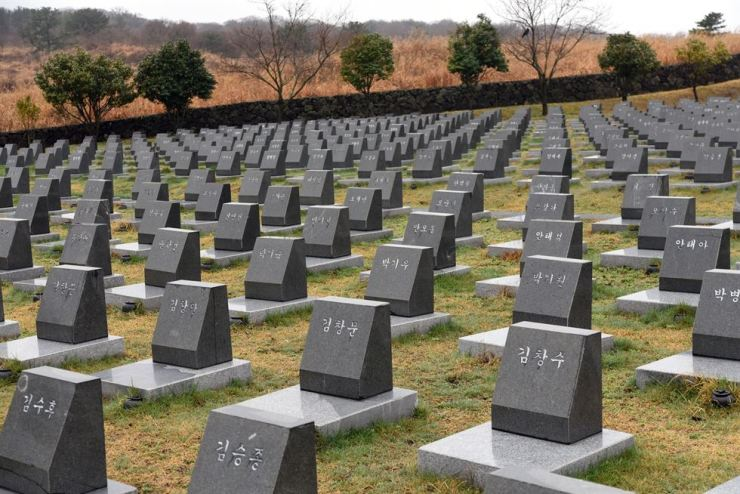 Empty tombs placed in the Jeju 4.3 Peace Park commemorate 3,895 people whose bodies were never recovered after being arrested without due process. / Korea Times photo by Jon Dunbar