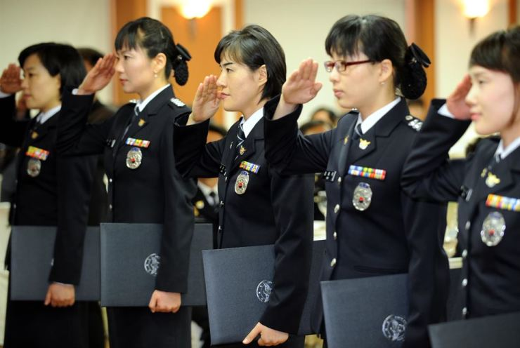 Female police officers pose for a photo during a ceremony in this 2008 file photo. / Korea Times file