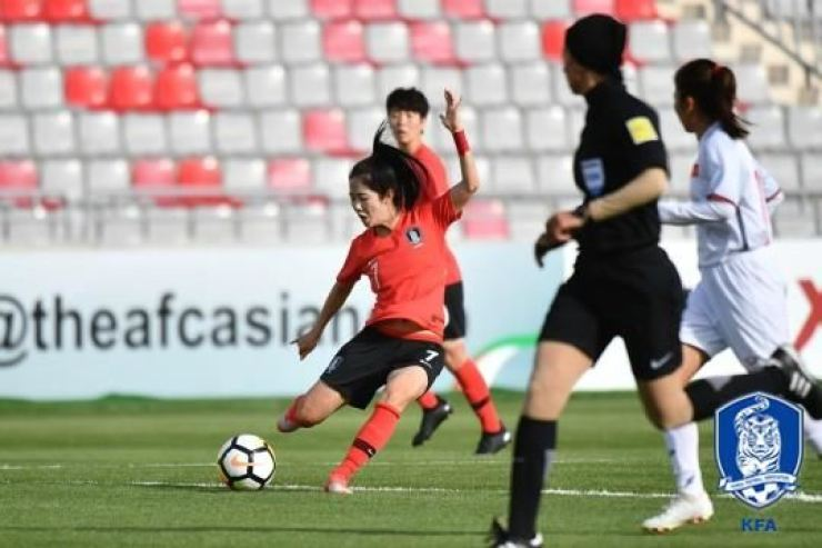 South Korea's Lee Min-a tries a shot during a Group B match against Vietnam during the Women's Asian Cup in Amman, Jordan, Saturday. / Courtesy of Korea Football Association