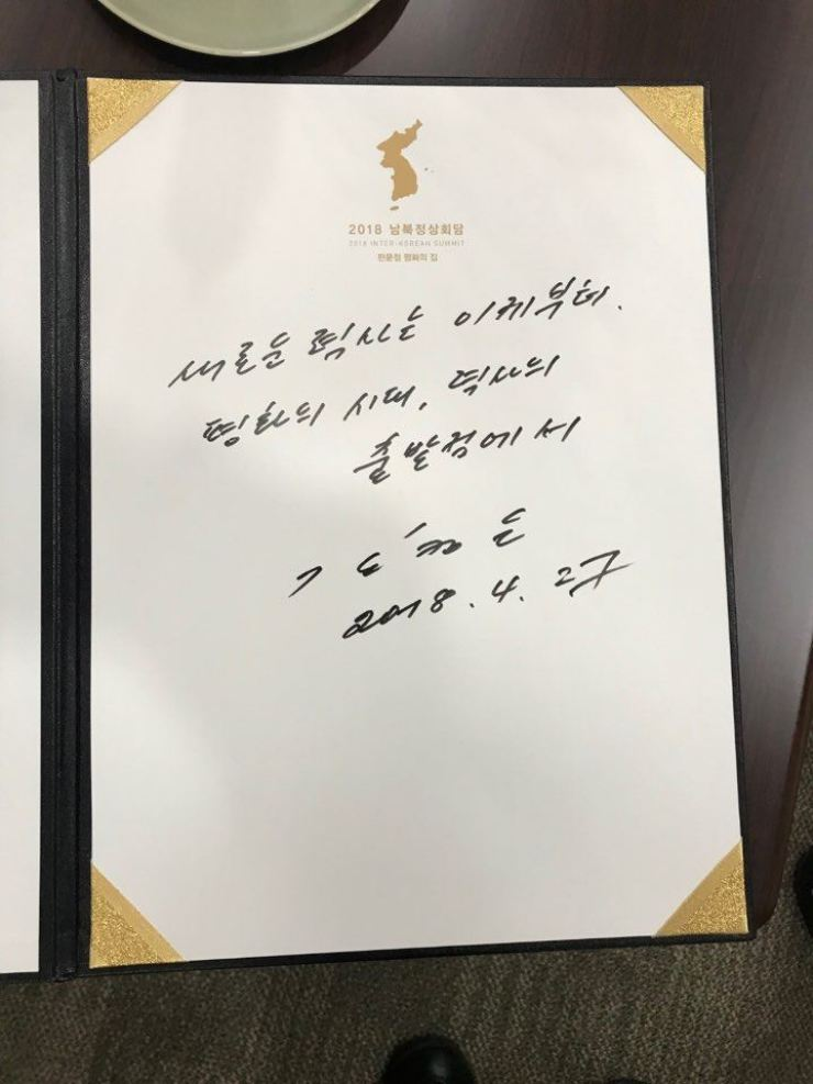 North Korean leader Kim Jong-un wrote a specially prepared message for the summit in the visitors' book at Peace House on the south side of Panmunjeom in Paju, Gyeonggi Province, Friday. It said: 'A new history begins now. The era of peace stands at the starting point.' The message ends with his name and date. / Korea Summit Press Pool