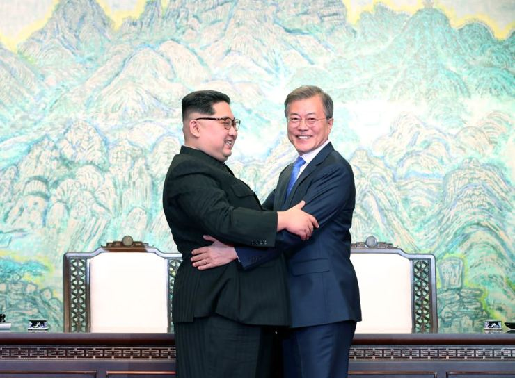North Korean leader Kim Jong-un with President Moon Jae-in. / Korea Times