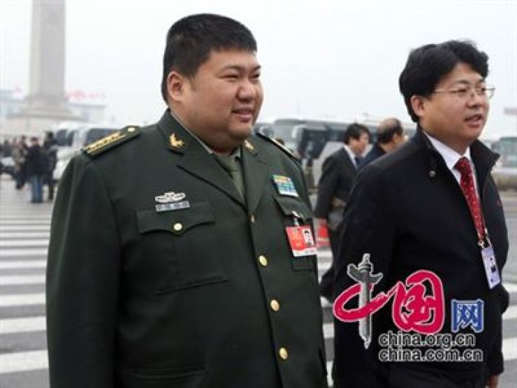 Mao Xinyu, left, became the youngest Major General of the People's Liberation Army of China, according to Chinese newspaper Ming Pao in Hong Kong, August 2010. / Korea Times file