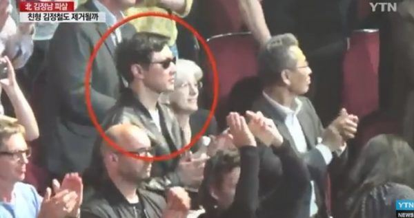Thae Yong-ho, right, escorts North Korean leader Kim Jong-un's elder brother, Kim Jong-chul, to an Eric Clapton concert in London in 2015. / Captured from Japanese TBS TV