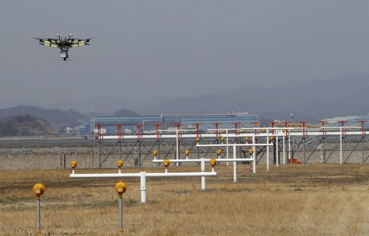 Korea Airports Corporation uses drones to check its regional airports' navigational system. / Yonhap