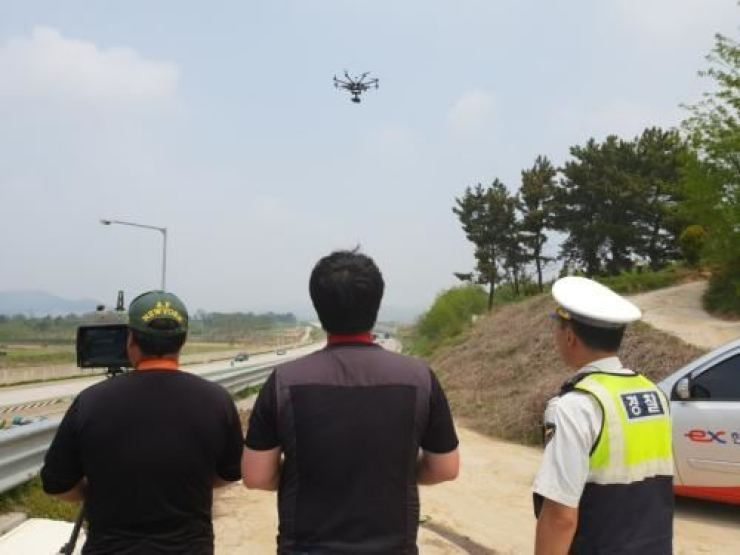 A policeman and operators keep tabs on a drone over a South Jeolla highway. / Courtesy of South Jeolla Province police