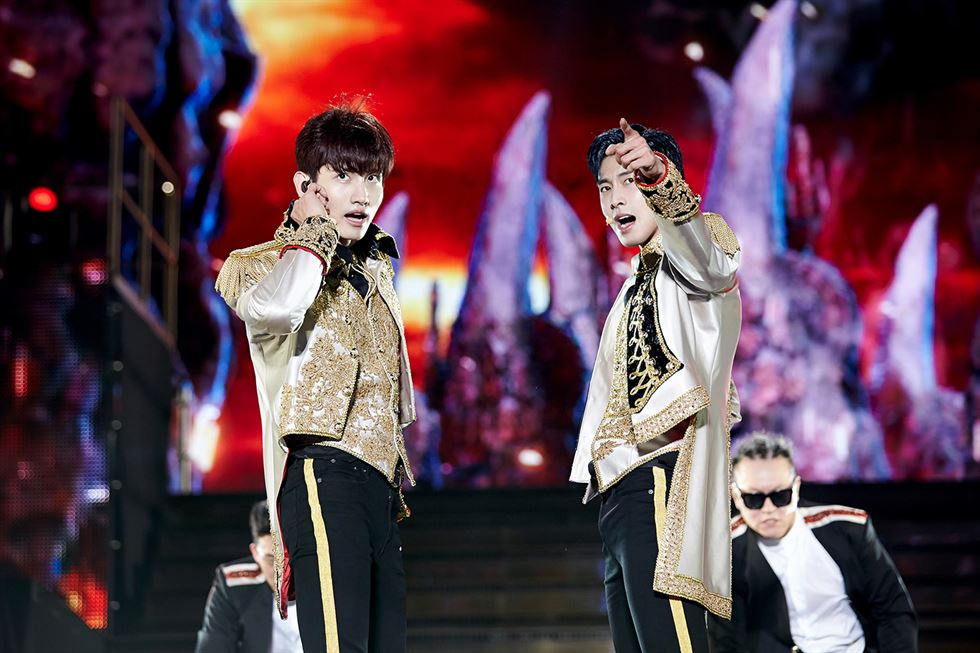 TVXQ's Changmin, left, and Yunho perform the song 'Something' during their concert held at Auxiliary Stadium of Jamsil Sports Complex in southeastern Seoul, Sunday. / Courtesy of SM Entertainment