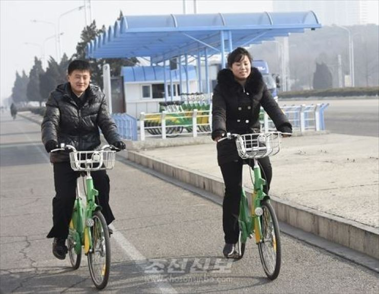 Pyongyang citizens ride public bikes provided by the city's Ryomyong. / From Choson Sinbo