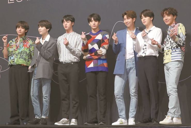 Members of K-pop band BTS gesture at Lotte Hotel in central Seoul on Thursday during a press conference for their third album 'Love Yourself: Tear.' They met with reporters days after they won the Billboard Top Social Artist Award on May 20. Their third album topped the Billboard 200 albums chart on Monday, 10 days after its release. / Yonhap