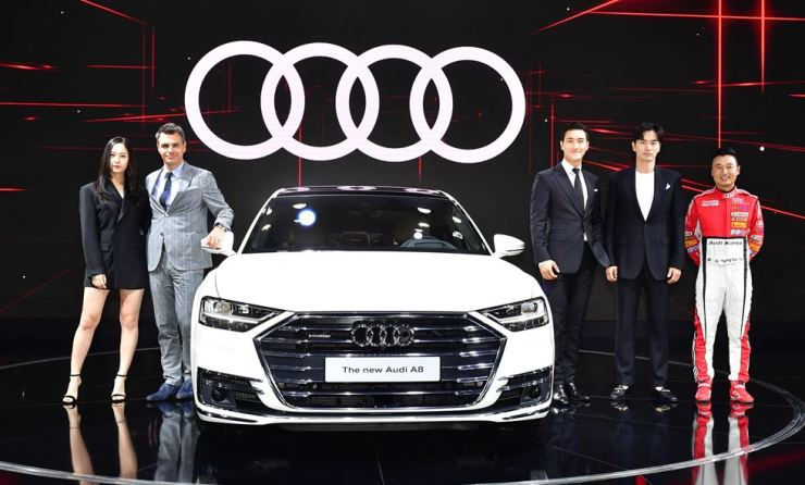 Audi Korea Managing Director Cedric Journel, second from left, introduces the A8 sedan during a press conference before the opening of the Busan International Motor Show at BEXCO, Thursday. From left are Audi ambassadors singer Krystal, Journel, singer Choi Si-won, actor Lee Jin-wook and car racer Ryu Kyung-wook. / Courtesy of Audi Korea