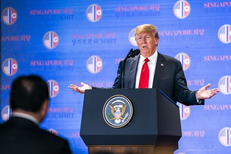 U.S. President Donald Trump speaks to the media about his historic meeting with North Korean leader Kim Jong-un at the the Capella Hotel in Singapore, June 12. EPA-Yonhap
