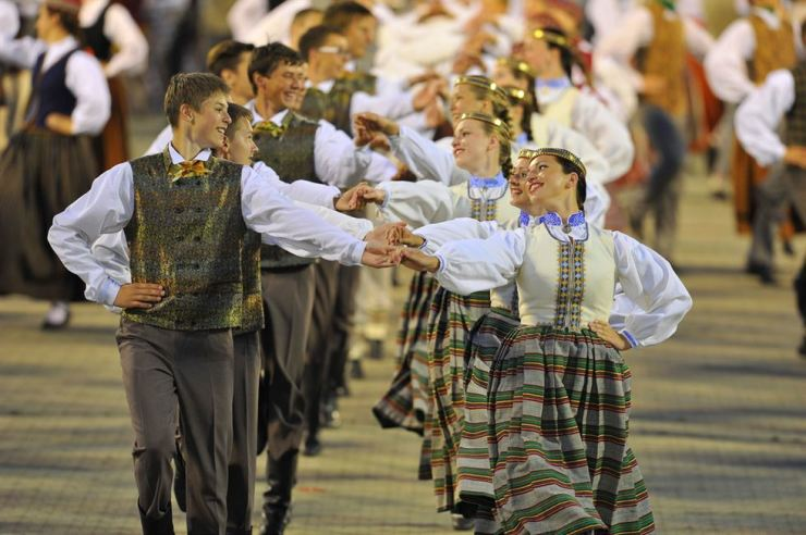 Folk dancers participate in the 'Latvian Song and Dance Festival' in the capital Riga. The UNESCO-registered festival is held every five years. This year's event will take place from June 30 to July 8. / Courtesy of Investment and Development Agency of Latvia