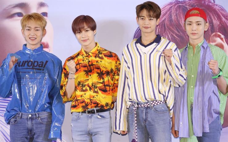 Members of SHINee pose during a press conference for their sixth full-length album 'The Story of Light' at Grand Intercontinental Seoul Parnas in southern Seoul, Monday. / Yonhap