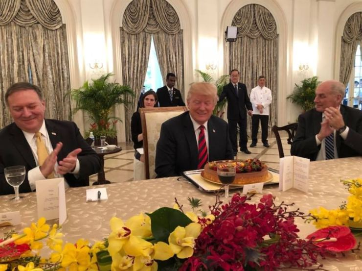 Donald Trump's 72nd birthday on June 14 was celebrated in advance by Singapore ministers and American officials during the American President's lunch with Singapore Prime Minister Lee Hsien Loong at Istana, Monday. The photo with and U.S. Secretary of State Mike Pompeo to Trump's right and Chief of Staff John Kelly to his left, was posted on Facebook by Singapore's Foreign Minister Vivian Balakrishnan.