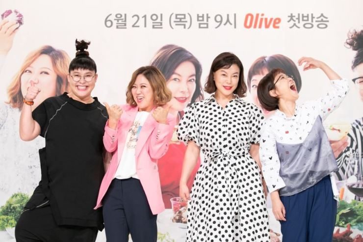 Cast members of Olive TV's new food show 'Food Bless You' pose at an event held at Times Square mall in Yeongdeungpo-gu, Seoul, last Monday. / Courtesy of Olive TV
