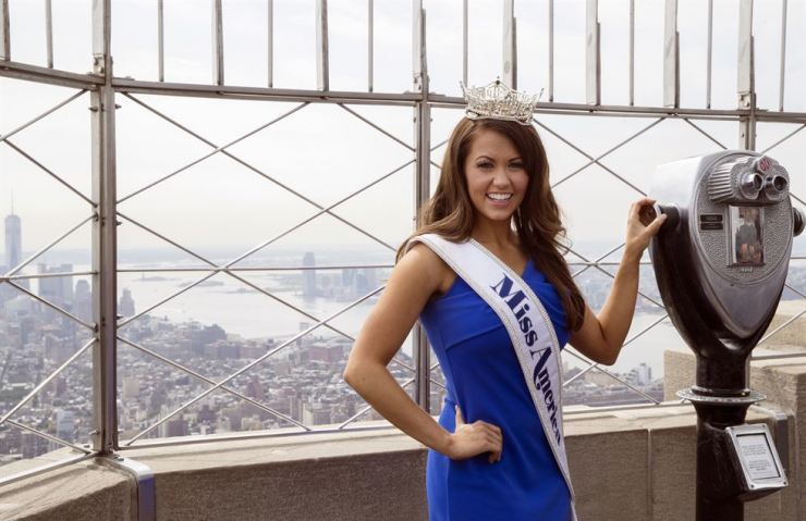 In this Sept. 12, 2017, file photo, newly-crowned Miss America 2018 Cara Mund poses for photographers on the 86th Floor Observation Deck of the Empire State Building, in New York. Mund, who will be the last Miss America to have worn a swimsuit onstage, says the pageant is right to eliminate that part of the competition. / AP