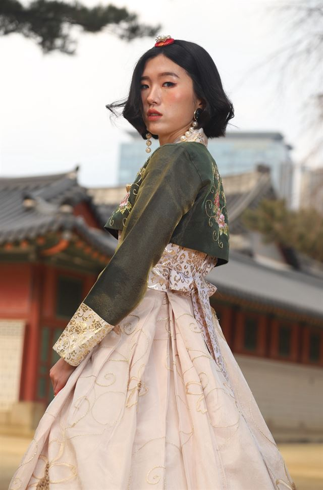 A gaeryang hanbok in the city, a place of dirty, dusty, and difficult compressed modernity and a perfect backdrop for a bright and shiny retake on tradition, with a bright and shiny model.