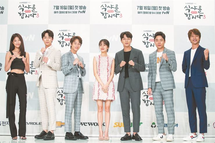 The cast of tvN's eating show 'Let's Eat: Begins,' including lead actor Yoon Doo-joon, third from right, pose for a photo during a press event at Times Square in southwestern Seoul, Tuesday. / Courtesy of CJ ENM