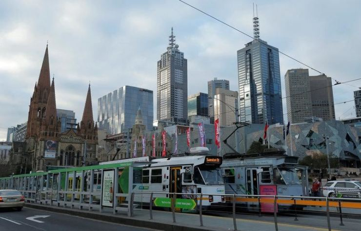 Trams pass Melbourne's city skyline. Reuters