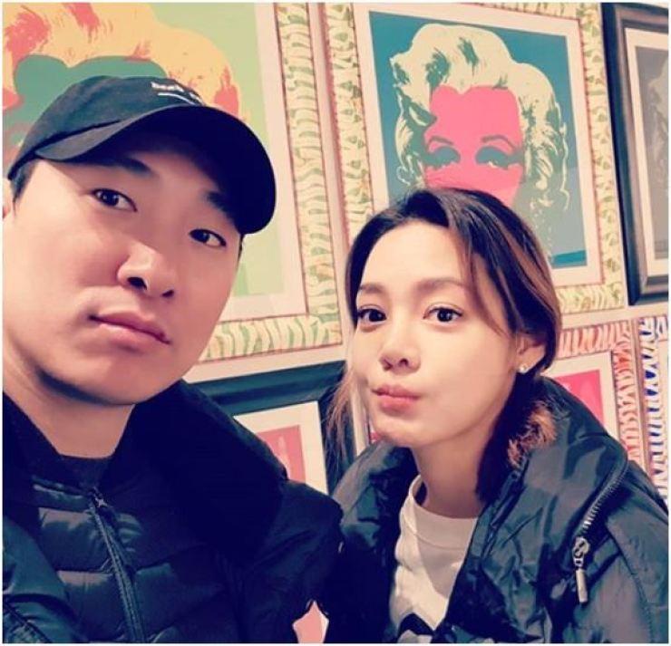 Interpreter Ahn Hyun-mo and her husband rapper-CEO Rhymer. Captured from Instagram