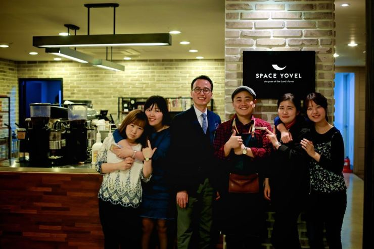 Joseph Park, third from right, poses with employees of his coffee shop Yovel in Hannam-dong, Seoul. / Courtesy of Joseph Park