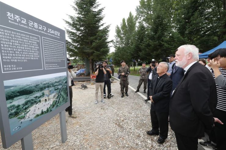 Archbishop Paul Richard Gallagher from the Vatican, right, visits the Roman Catholic JSA Church of Military Ordinariate of Korea construction site at the inter-Korean border village Panmunjeom, Thursday. Yonhap