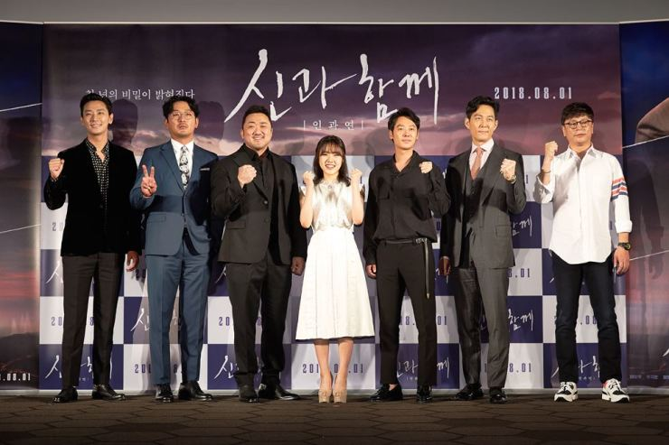 From left, Ju Ji-hoon, Ha Jung-woo, Ma Dong-seok and other cast members of the fantasy film 'Along with the Gods: The Last 49 Days' pose at a press conference at Lotte Cinema in Seoul on July 6. /Courtesy of Lotte Entertainment
