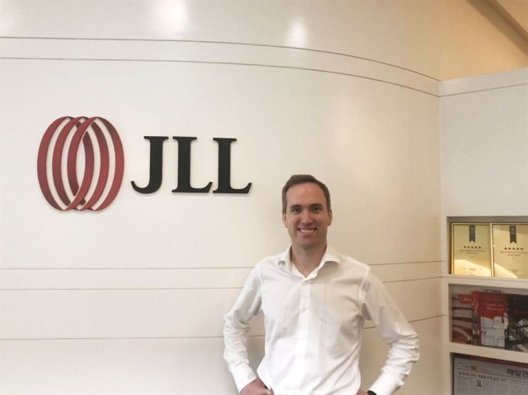 JLL Korea National Director Richard Orbell poses in front of the company's entrance at the IFC on Yeouido, Seoul, July 17. / Courtesy of JLL Korea