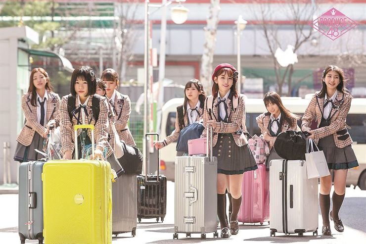 Japanese idol trainees arrive at Mnet headquarters in Seoul last month for the music show 'Produce 48.' Dozens of aspiring singers from Korea and Japan compete on the reality show to make the cut for a 12-member girl group that will be formed at the end of the show.