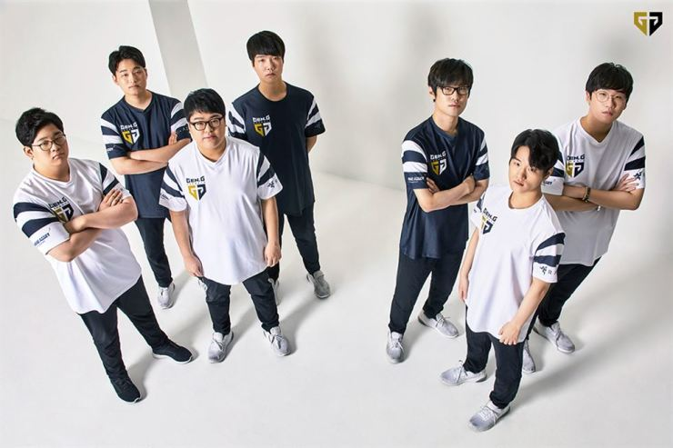 Members of GenG LoL, one of the five esports teams managed by Gen.G esports, pose for a photo. From left are Kim Jung-min (Life), Jo Yong-in (CoreJJ), Lee Seong-jin (CuVee), Kang Min-seung (Haru), Kang Chan-yong (Ambition), Lee Min-ho (Crown) and Park Jae-hyuk (Ruler). Among them, Jo and Park will participate in the upcoming Asian Games where esports will feature as a demonstration event for the first time. / Courtesy of Gen.G esports