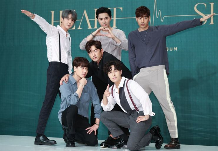 Members of boy band Shinhwa pose during a press conference held at Amoris Hall at Times Square in Seoul on Tuesday. The K-pop band recently released their new album 'Heart.' Yonhap
