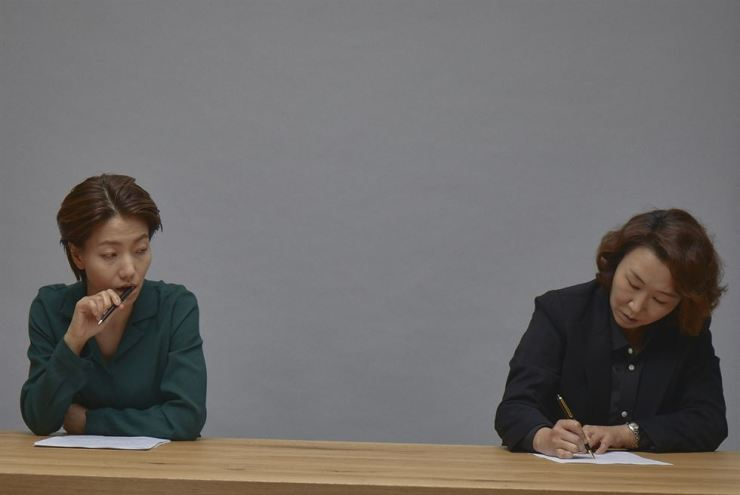 A scene from the play 'El Critico,' starring Kim Sin-rok, left, as playwright Scarpa and Baek Hyun-joo as critic Volodia / Courtesy of SZR Theatre