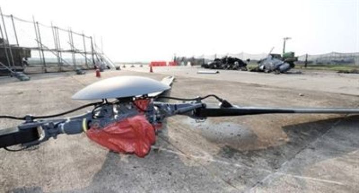 Seen above are rotor blades separated from an ill-fated Surion helicopter that crashed last month at a military airfield in Pohang, North Gyeongsang Province. The accident left five soldiers aboard dead. / Yonhap