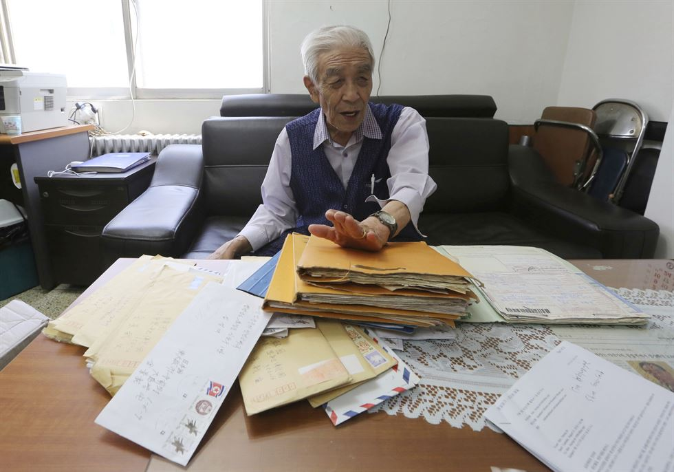 In this Aug. 22, 2018, photo, Shim Goo-seob, 83, shows a photo of his family member during an interview at his office in Seoul, South Korea. Only a fraction of the elderly Koreans separated by the Korean War are able to attend the on-and-off reunions organized by their rival governments. So some South Koreans turn to unofficial networks of brokers, friends and others to correspond with their loved ones in the North. Shim said he has arranged face-to-face reunions in China among North and South Koreans via his own network of brokers and helpers. AP-Yonhap
